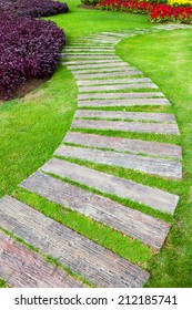 Railway sleepers used to make the pathway on the lawn in the garden.