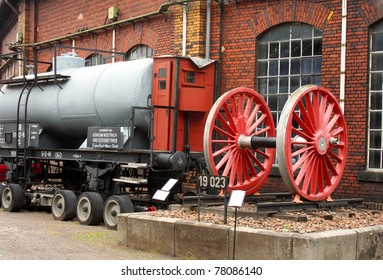 railway station brick house and tank car and red wheel