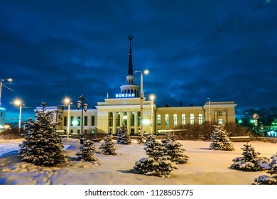 Railway station building in Petrozavodsk, Russia in a winter day. Letters say 'Railway station' in russian language