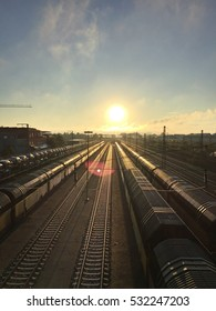 Railway station with freight trains in sunset
