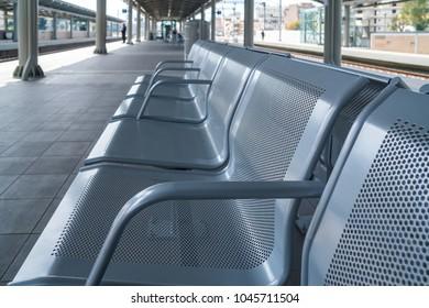 Railway station lounge waiting hall metal chair.