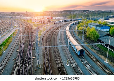Railway station with wagons during sunrise from above. Reconstructed modern railway infrastructure.