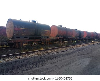 Railway tanker wagons which are transporting the furnace oil are parked at a railway line. Logistics by rail is by far the cheapest method for transporting the bulk cargo.