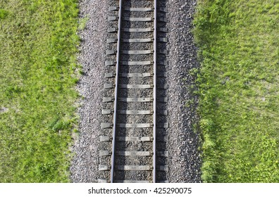 Railway top view. Railroad and green grass on the sides. The part of rail track for trains.
