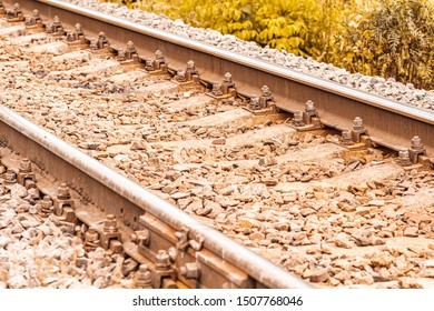 Railway track close-up. Railway track rails and sleepers. Side view