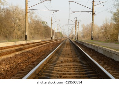 The railway track, going off into the distance, on the side-platform for landing