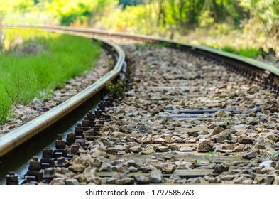 Railway track making a curve to the left.