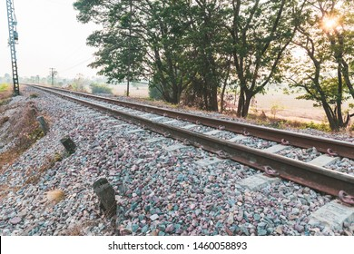 Railway track on crushed stone base, infrastructure in countryside