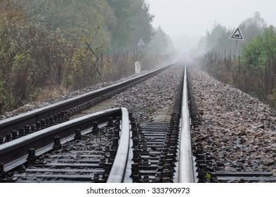 Railway track on gravel embankment