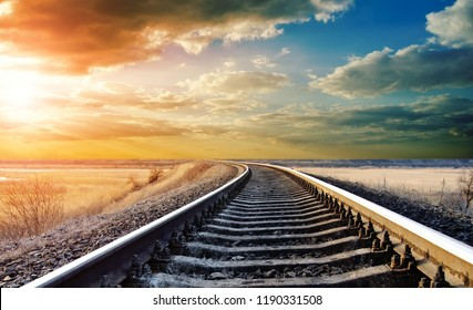 Railway track photo under beautiful sky