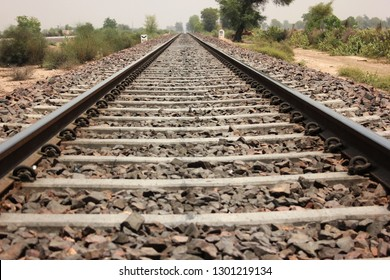 Railway track view, broad gauge, train track and gravel background