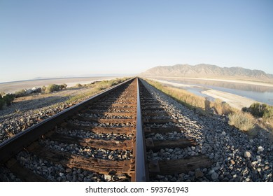 Railway tracks across the great salt lake landscape format