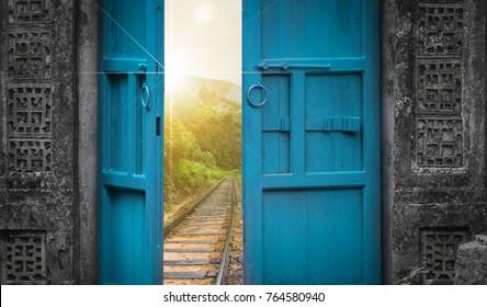 railway tracks behind open door