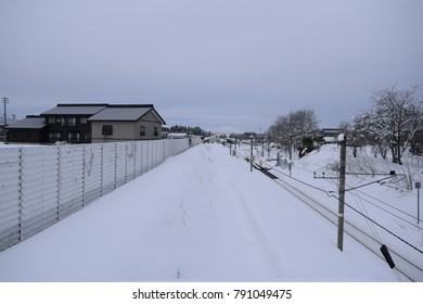 Railway tracks covered in snow
