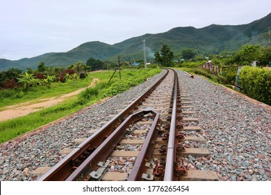 railway tracks.  Line of railway crossing in rural of Thailand.  Railway tracks and railway Tha Chomphu Bridge view at Lamphun.