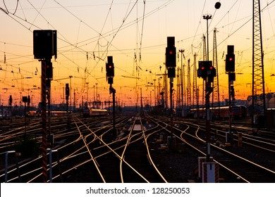 Railway Tracks at a Major Train Station at Sunset.