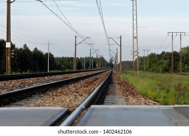 railway tracks on the crossing with visible electric traction