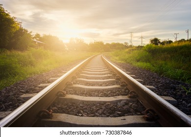 Railway tracks with sunset background.