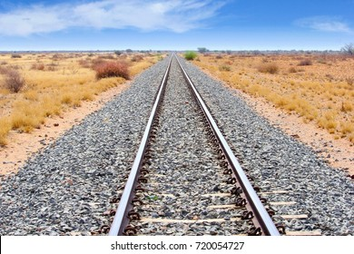 Railway tracks and train journey in typical African savanna landscape, Namibia, Africa