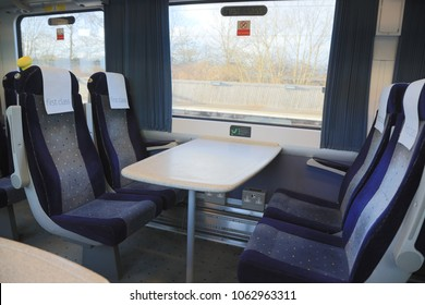 Railway train carriage with empty first class seats. West Midlands Trains. London, UK - 3rd April 2018.