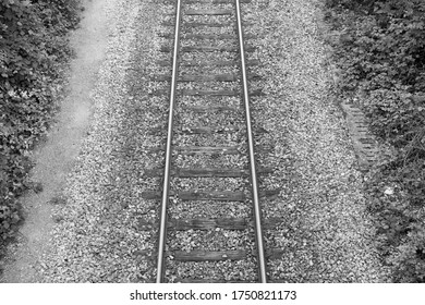 Railway, train tracks close up. Beautiful details of the iron and gravel. Black and white.