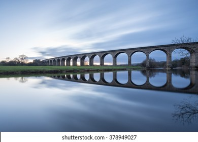 Railway viaduct, no train - the Arthington Viaduct and the mirror calm River Wharfe in West Yorkshire