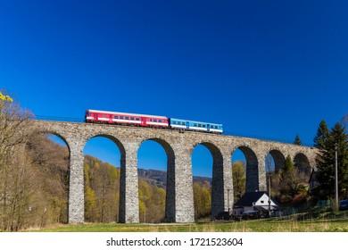Railway viaduct Novina in Krystofovo udoli, Northern Bohemia, Czech Republic - Shutterstock ID 1721523604