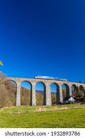 Railway viaduct Novina in Krystofovo udoli, Northern Bohemia, Czech Republic - Shutterstock ID 1932893786