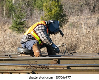 Railway welder working on a rail