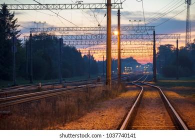 Railways at dusk. Summer night