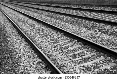 Railways sleepers and stones background in perspective black and white