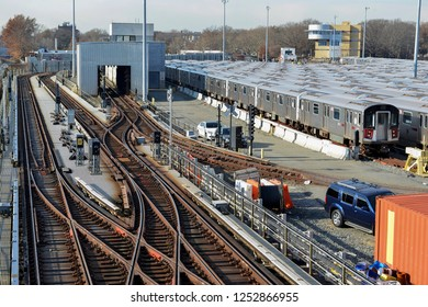 Railyard with trains and railroad tracks