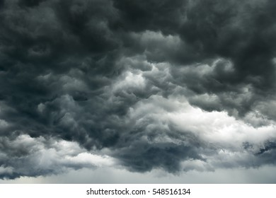 Rain clouds background.Clouds become dark gray like a big smoke before rainfall.Thunderstorm is a storm with lightning and thunder. Air pilots know that they must never fly through a thunder cloud.