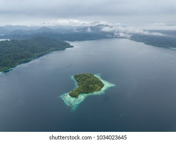 Rain clouds drift over the island of Batanta in Raja Ampat, Indonesia. This remote, tropical region is famous for its incredible marine biodiversity.