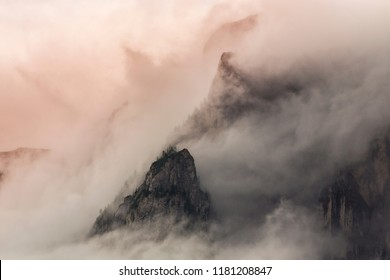 Rain clouds and mist at sunset in the Dolomite Mountains, Italy, in autumn