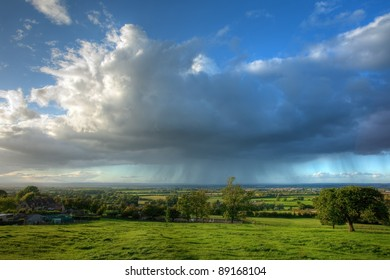 Rain clouds over English countryside in Summer