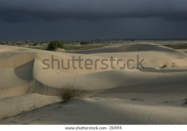 Rain clouds over sand dunes of Sabaki River Kenya