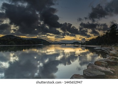 Rain Clouds, Reflections and Bay Waterscape - Sunrise at Woy Woy Waterfront on the Central Coast, NSW, Australia.