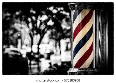 Rain collecting on the barber shop pole at Island Barbers in Coronado, California.