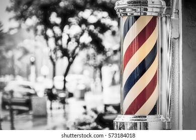 Rain collecting on the barber shop pole at Island Barbers in Coronado, California.