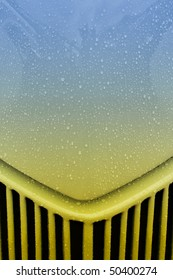 rain covered hot-rod grille abstract with gradient color from blue to yellow