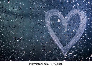 rain drop heart on glass background