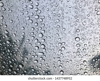Rain drop on mirror can be used for display or nature background concept. Copy space for your text or design.