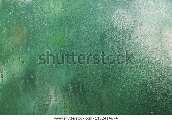 Rain drop on mirror in cloudy day, refreshing relaxing background texture