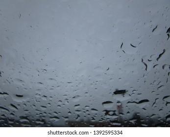 Rain droplets on a car windshield 2019