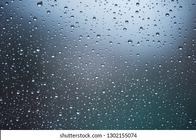 Rain droplets on window with out of focus background