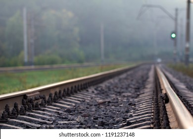 Rain drops broke on the rail. The photo symbolizes nostalgia and loneliness.