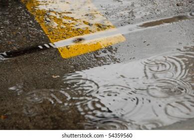 Rain drops falling on 8th Street in Boise