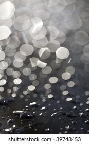 rain drops on black car