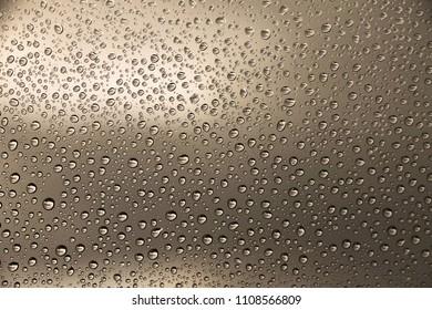 Rain drops on brown window glass , rainy day